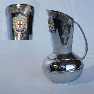 CHROME EWER BEARING  THE CITY OF LONDON COAT OF ARMS BADGE.